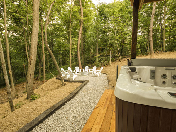 Hot tub on patio and fire ring